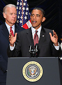 WASHINGTON - JULY 21:  U.S. President Barack Obama speaks as United States Vice President Joe Biden looks on as U.S. President Barack Obama makes remarks before signing the Dodd-Frank Wall Street Reform and Consumer Protection Act at the Ronald Reagan Building, Wednesday, July 21, 2010 in Washington, DC. The bill is the strongest financial reform legislation since the Great Depression and also creates a consumer protection bureau that oversees banks on mortgage lending and credit card practices. .Credit: Win McNamee - Pool via CNP