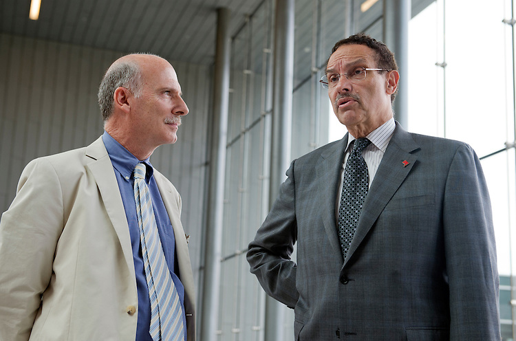 UNITED STATES - JULY 22: D.C. Mayor Vincent Gray, right, and Council chairman Phil Mendelson, talk before a news conference at the new Coast Guard headquarters which will open next month at St. Elizabeths West Campus in Anacostia. (Photo By Tom Williams/CQ Roll Call)