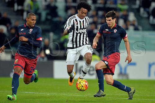 03.02.2016. Juventus Stadium, Turin, Italy. Serie A Football. Juventus versus Genoa. Gabriel Silva and Ezequiel Munoz challenge Juan Cuadrado