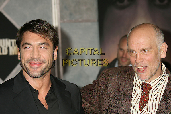 "JAVIER BARDEM & JOHN MALKOVICH.""No Country For Old Men"" Los Angeles Premiere held at the El Capitan Theatre, Hollywood, California, .USA,  4 November 2007..portrait headshot.CAP/ADM/RE.©Russ Elliot/AdMedia/Capital Pictures."