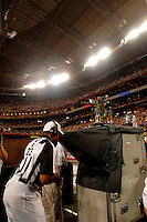 Oct. 16, 2006; Glendale, AZ, USA; A referee review a coaches challenge by the Arizona Cardinals against the Chicago Bears at University of Phoenix Stadium in Glendale, AZ. Mandatory Credit: Mark J. Rebilas