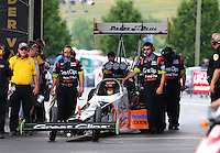 Jun 21, 2015; Bristol, TN, USA; Crew members wait with NHRA top fuel driver Clay Millican during the Thunder Valley Nationals at Bristol Dragway. Mandatory Credit: Mark J. Rebilas-