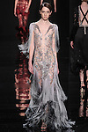 """Model walks runway in a lavender silk fringe dress from the Reem Acra Fall 2016 """"The Secret World of The Femme Fatale"""" collection, at NYFW: The Shows Fall 2016, during New York Fashion Week Fall 2016."""