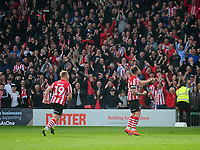 Lincoln City's Neal Eardley celebrates scoring his side's equalising goal to make the score 1-1<br /> <br /> Photographer Andrew Vaughan/CameraSport<br /> <br /> The EFL Sky Bet League Two - Lincoln City v Macclesfield Town - Saturday 30th March 2019 - Sincil Bank - Lincoln<br /> <br /> World Copyright © 2019 CameraSport. All rights reserved. 43 Linden Ave. Countesthorpe. Leicester. England. LE8 5PG - Tel: +44 (0) 116 277 4147 - admin@camerasport.com - www.camerasport.com
