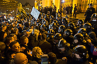 Demonstrators clash with a line of police during a protest against government corruption in front of the building of the Hungarian Parliament in Budapest, Hungary on November 17, 2014. ATTILA VOLGYI