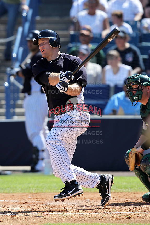New York Yankees second baseman David Adams #80 at bat during a scrimmage against the USF Bulls at Steinbrenner Field on March 2, 2012 in Tampa, Florida.  New York defeated South Florida 11-0.  (Mike Janes/Four Seam Images)