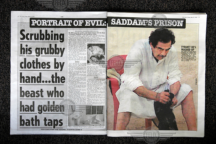 A picture in British newspaper 'The Sun' depicting former Iraqi President Saddam Hussein in his prison cell. The publication of a series of covert photographs of Hussein in US military custody provoked criticism for possibly breaching the Geneva Convention on the treatment of prisoners of war (PoWs).