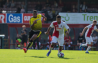 Mamadou Obbi Oulare of Watford chases down the ball during the Pre Season Friendly match between Woking and Watford at the Kingfield Stadium, Woking, England on 10 July 2016. Photo by Andy Rowland.