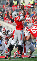 Ohio State Buckeyes quarterback J.T. Barrett (16) almost fumbles the reception in the third quarter of their game at Ohio Stadium in Columbus, Ohio on November 22, 2014. (Columbus Dispatch photo by Brooke LaValley)