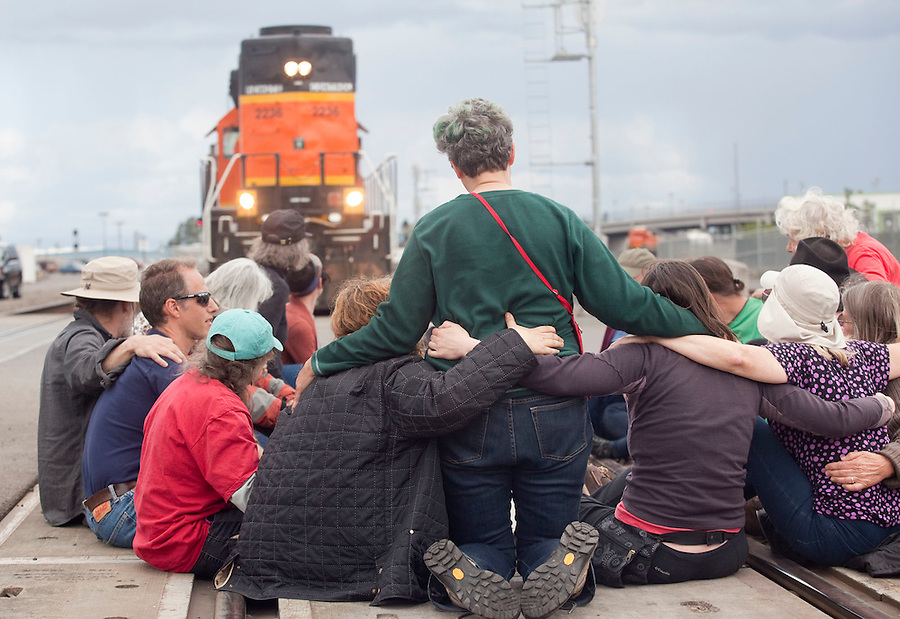 Protesters take part in a demonstration, blocking BNSF railroad tracks in Vancouver Saturday June 18 2016. (Photo by Natalie Behring for the Columbian)