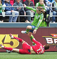 Seattle Sounders FC midfielder Erik Friberg  attemps to jump over Chicago Fire defender Gonzalo Segares during play at Qwest Field in Seattle Tuesday April 8, 2011. The Sounders won the game 2-1.