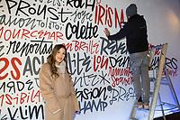 """EXCLUSIF : Iris Mittenaere avec l'artiste peintre et tagueur Denis Meyers, lors de la dédicace de son livre """" Toujours y croire """", à la librairie Filigranes, à Bruxelles.<br /> Belgique, Bruxelles, 12 décembre 2018<br /> Iris Mittenaere , French model, television presenter, and beauty pageant titleholder who was crowned Miss Universe 2016, during a booksigning of ' Toujours y croire ', at Filigranes in Brussels.<br /> Belgium, Brussels, 12 December 2018."""