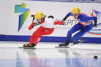 "SHORT TRACK: MOSCOW: Speed Skating Centre ""Krylatskoe"", 13-03-2015, ISU World Short Track Speed Skating Championships 2015, 500m Men, Charles HAMELIN (#110 | CAN), Jon ELEY (#121 | GBR), ©photo Martin de Jong"