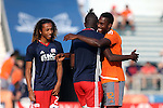 15 June 2016: Carolina's James Marcelin (HAI) (42) and New England's Kei Kamara (SLE) (center) embrace as Zachary Herivaux (JPN) (left) watches. The Carolina RailHawks hosted the New England Revolution at WakeMed Stadium in Cary, North Carolina in a 2016 Lamar Hunt U.S. Open Cup fourth round game.
