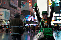 A reveler gestures in Times Square as she takes part in the 252nd annual St. Patrick's Day Parade in New York City. Photo by Eduardo Munoz Alvarez / VIEWpress.