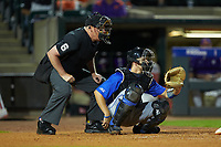 Home plate umpire Frank Sylvester stands behind Chris Proctor (23) of the Duke Blue Devils during the game against the Clemson Tigers in Game Three of the 2017 ACC Baseball Championship at Louisville Slugger Field on May 23, 2017 in Louisville, Kentucky. The Blue Devils defeated the Tigers 6-3. (Brian Westerholt/Four Seam Images)