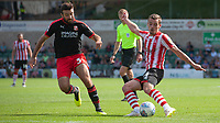 Lincoln City's Harry Toffolo crosses the ball despite the attentions of Swindon Town's Michael Doughty<br /> <br /> Photographer Chris Vaughan/CameraSport<br /> <br /> The EFL Sky Bet League Two - Lincoln City v Swindon Town - Saturday 11th August 2018 - Sincil Bank - Lincoln<br /> <br /> World Copyright &copy; 2018 CameraSport. All rights reserved. 43 Linden Ave. Countesthorpe. Leicester. England. LE8 5PG - Tel: +44 (0) 116 277 4147 - admin@camerasport.com - www.camerasport.com