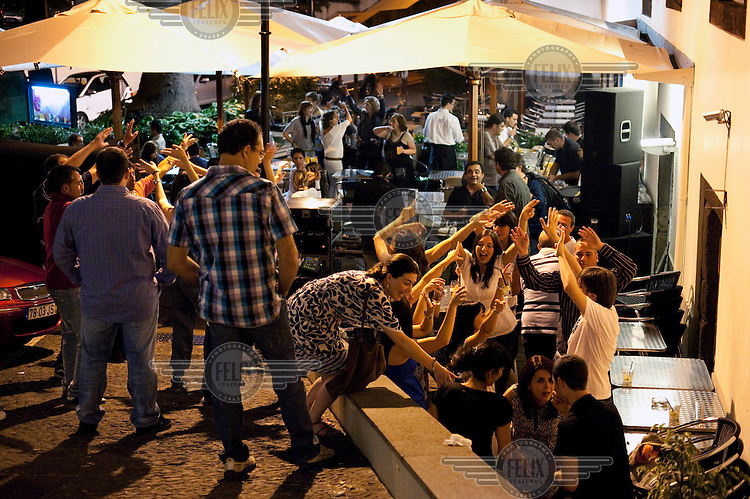 People dance at the FX Club in Funchal.