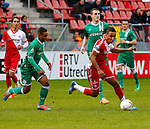 Nederland, Utrecht, 23 februari 2014<br /> Eredivisie<br /> Seizoen 2013-2014<br /> FC Utrecht-FC Groningen<br /> Juan Agudelo (r.) van FC Utrecht in actie met bal. Links Lorenzo Burnet van FC Groningen.