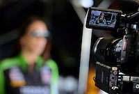 Sept. 28, 2012; Madison, IL, USA: NHRA funny car driver Alexis DeJoria is shown on a video camera as she is interviewed during qualifying for the Midwest Nationals at Gateway Motorsports Park. Mandatory Credit: Mark J. Rebilas-