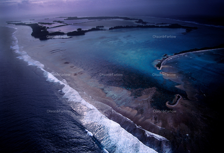 "The largest purchase to date for the Nature Conservancy is the Palmyra an atoll situated about 300 miles north of the equator.  Palmyra has five times as many coral species as the Florida Keys and three times as many as Hawaii.  It is home to the world's largest invertebrate, the rare coconut crab, and a population of red-footed booby birds second only to that of the Galapagos.  It is the last marine wilderness area left in the U.S. tropics and is home to the last remaining stands of Pisonia grandis beach forest in the world.  Palmyra was a US Navy supply base in World War II, the site of a proposed nuclear waste dump, an unsuccessful coconut plantation and of various development schemes.  Palmyra is most famous for the 1974 slaying  of a married couple which became the subject of the best-selling book ""And the Sea Will Tell,"" by Vincent Bugliosi."