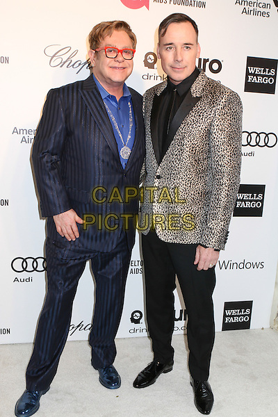 WEST HOLLYWOOD, CA - MARCH 2: Sir Elton John, David Furnish attending the 22nd Annual Elton John AIDS Foundation Academy Awards Viewing/After Party in West Hollywood, California on March 2nd, 2014. <br /> CAP/MPI/COR99<br /> &copy;COR99/MediaPunch/Capital Pictures