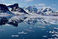 Mountains reflected in ice free sea during the short arctic summer. Hornsund Spitsbergen