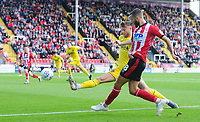 Lincoln City's Jorge Grant crosses the ball despite the attentions of Fleetwood Town's Wes Burns<br /> <br /> Photographer Chris Vaughan/CameraSport<br /> <br /> The EFL Sky Bet League One - Lincoln City v Fleetwood Town - Saturday 31st August 2019 - Sincil Bank - Lincoln<br /> <br /> World Copyright © 2019 CameraSport. All rights reserved. 43 Linden Ave. Countesthorpe. Leicester. England. LE8 5PG - Tel: +44 (0) 116 277 4147 - admin@camerasport.com - www.camerasport.com