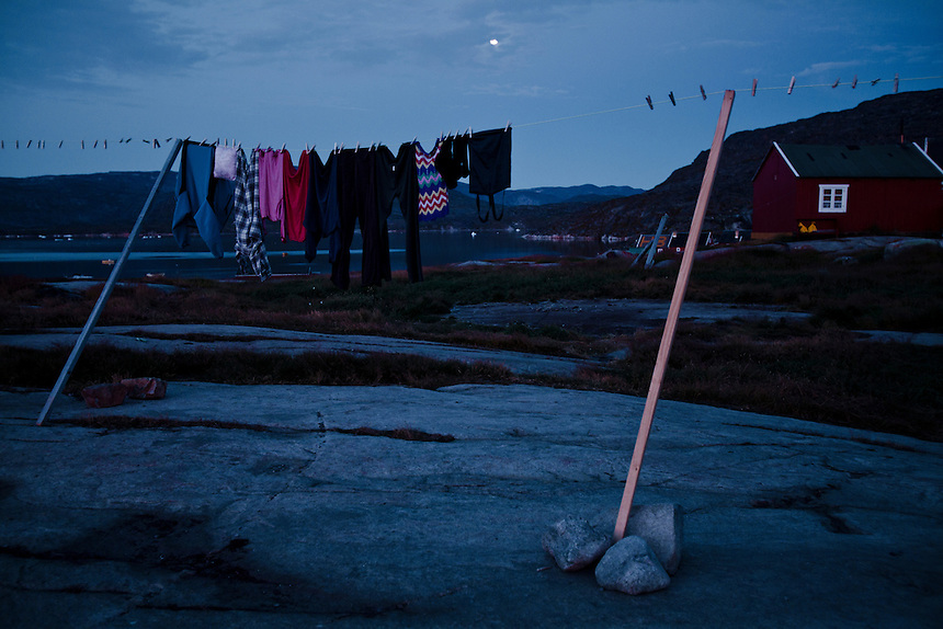 Washing hangs on a clothes line in the midnight summer light, Rodebay, West Greenland, August 2011. Many local inhabitants say the summer has grown longer in recent years, bringing warmer temperatures later into the year. Photo: Ed Giles.