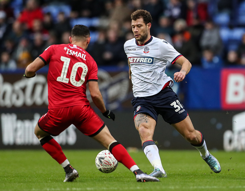 Bolton Wanderers' Yanic Wildschut competing with Walsall's Zeli Ismail<br /> <br /> Photographer Andrew Kearns/CameraSport<br /> <br /> Emirates FA Cup Third Round - Bolton Wanderers v Walsall - Saturday 5th January 2019 - University of Bolton Stadium - Bolton<br />  <br /> World Copyright © 2019 CameraSport. All rights reserved. 43 Linden Ave. Countesthorpe. Leicester. England. LE8 5PG - Tel: +44 (0) 116 277 4147 - admin@camerasport.com - www.camerasport.com