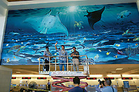 Wyland's Whaling Wall #091 'Guam's Ocean Life' Guam International Airport Hagatna, Guam 33 Feet Long x 50 Feet High Dedicated February 19, 2004 by Governor Felix Camacho. The Whaling Walls by marine life artist Wyland - a quest to paint 100 life size murals which took 27 years, in 13 countries and four continents.