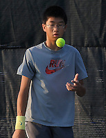 STAFF PHOTO FLIP PUTTHOFF <br /> Michael Zheng gets ready to serve during practice on Wednesday Aug. 6 2014 at Rogers High School.