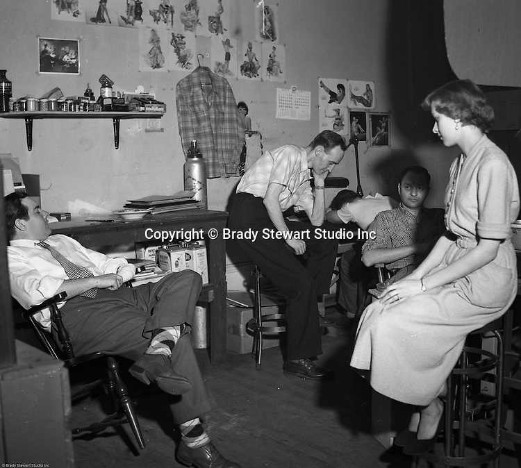 Pittsburgh PA:  Brady Stewart Studio staff listening to the McCarthy hearings on the radio - 1951.  Senator McCarthy chaired a Senate committee investigating the spread of communism throughout the government and private sector from 1950 to 1953.