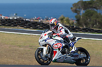 Jonathan Rea (GBR) riding the Honda CBR1000RR (65) of the Pata Honda World Superbike Team exits turn 10 during a practise session on day two of round one of the 2013 FIM World Superbike Championship at Phillip Island, Australia. rounds turn 11 during a practise session on day two of round one of the 2013 FIM World Superbike Championship at Phillip Island, Australia.