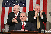 United States President George W. Bush delivers his State of the Union Address to a Joint Session of Congress in the Capitol in Washington, D.C. on February 2, 2005.  United States Vice President Dick Cheney, left, and the Speaker of the United States House of Representatives J. Dennis Hastert (Republican from the 14th District of Illinois), right, applaud from behind.<br /> Credit: Luke Frazza / Pool via CNP