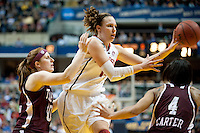 INDIANAPOLIS, IN - APRIL 3, 2011: Kayla Pedersen passes off to Jeanette Pohlen against Texas A&M at Conseco Fieldhouse during the NCAA Final Four  in Indianapolis, IN on April 1, 2011.