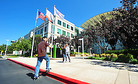Sept. 6, 2011 - Cupertino, California - U.S. - People pose for pictures at the Apple Inc. world headquarters Monday September 5, 2011. Apple is one of the worlds most valuable companies by market capitalization and recently eclipsed Exxon Mobile with a Market worth of about $349.32 billion. Iconic CEO Steve Jobs resigned on August 24, 2011, and the Board named Tim Cook, previously Apple's Chief Operating Officer, as the company's new CEO. (Credit Image: Alan Greth/ZUMAPress.com).