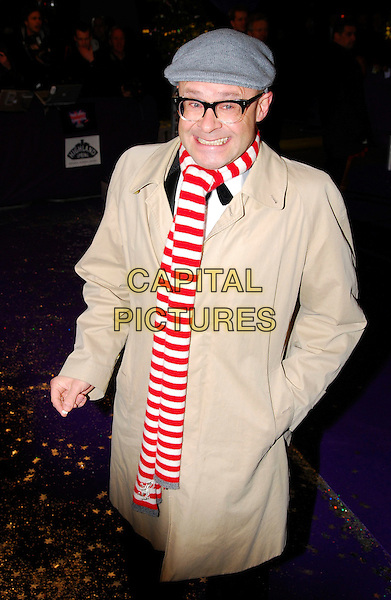 HARRY HILL.British Comedy Awards 2006, London Television Studios, London, UK. .December 13th, 2006.half length beige coat jacket red white striped stripes scarf grey gray hat hand in pocket funny face smiling.CAP/CAN.©Can Nguyen/Capital Pictures