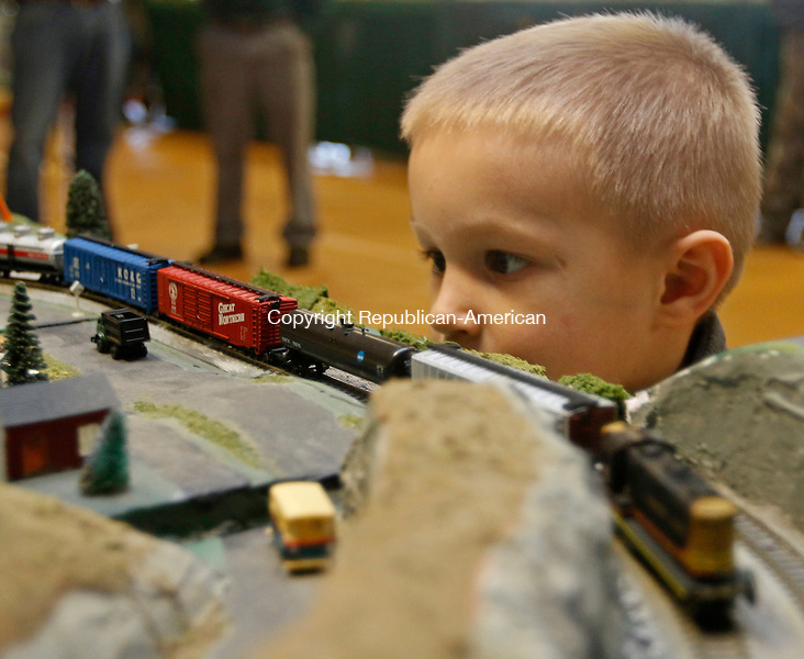Torrington, CT-11 December 121215MK05  Three year old Calaeb Bienkawski, from Torrington, is drawn to the movement along the tracks during the holiday model train show and canned food drive at the Torrington Armory. The free   annual event is hosted by the city and the Torrington Area Model Railroaders features layouts in HO and N scale trains.    The event will be open again today from 9 a.m. to 3 p.m. on Dec. 13.  Michael Kabelka / Republican-American