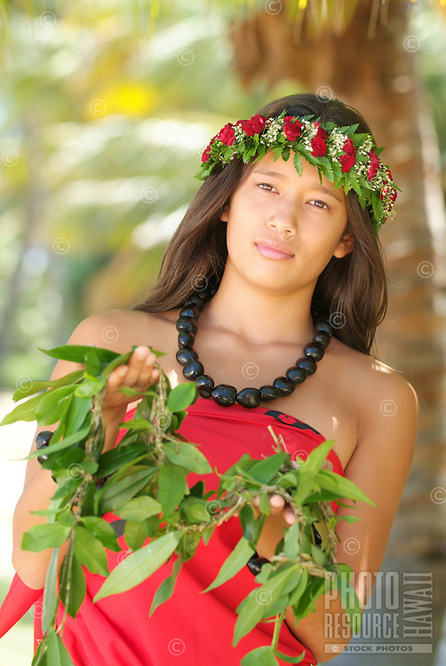 Young woman with maile lei