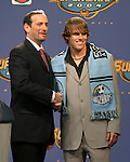16 January 2004: Matt Taylor (right) of UCLA, with MLS Commissioner Don Garber (left), was selected with the fourth overall pick of the draft by the Kansas City Wizards. The Major League Soccer SuperDraft was held at the Charlotte Convention Center in Charlotte, NC as part of the annual National Soccer Coaches Association of America convention...