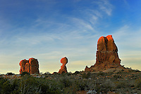 Trio of red rock formations including balanced rock in Arches national Park, Utah.