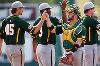 Baylor Bears catcher Josh Ludy #30 celebrates with teammate Kolt Browder #45 after the NCAA Regional baseball game against Oral Roberts University on June 3, 2012 at Baylor Ball Park in Waco, Texas. Baylor defeated Oral Roberts 5-2. (Andrew Woolley/Four Seam Images)