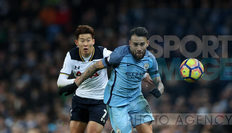 Nicolas Otamendi of Manchester City and Son Heung-Min of Tottenham Hotspur during the Premier League match at Etihad Stadium, Manchester. Picture date: January 21st, 2017.Photo credit should read: Lynne Cameron/Sportimage