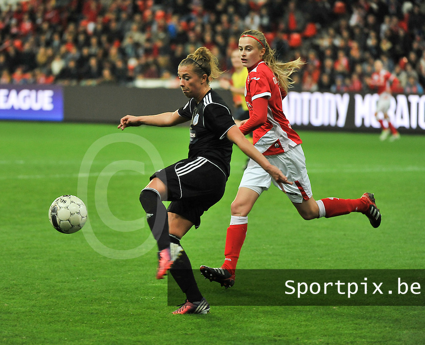 20131009 - LIEGE , BELGIUM : Glasgow Nicola Docherty (left) pictured with Standard's Julie Biesmans during the female soccer match between STANDARD Femina de Liege and  GLASGOW City LFC , in the 1/16 final ( round of 32 ) first leg in the UEFA Women's Champions League 2013 in stade maurice dufrasne - Sclessin in Liege. Wednesday 9 October 2013. PHOTO DAVID CATRY