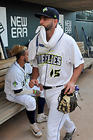 Starting pitcher Zac Grotz (15) of the Columbia Fireflies walks into the dugout before a game against the Charleston RiverDogs on Wednesday, August 29, 2018, at Spirit Communications Park in Columbia, South Carolina. Charleston won, 6-1. (Tom Priddy/Four Seam Images)