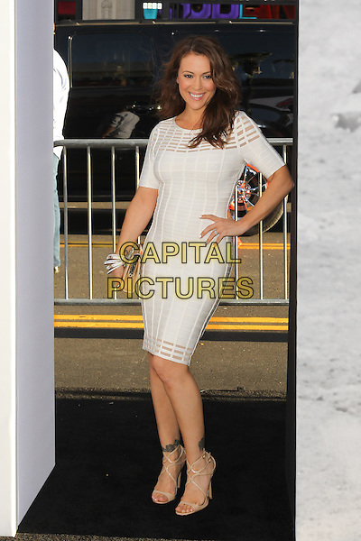 "Alyssa Milano.""42"" Los Angeles Premiere held at the TCL Chinese Theatre, Hollywood, California, USA..April 9, 2013.full length white dress hand on hip.CAP/CEL .©CelPh/Capital Pictures."