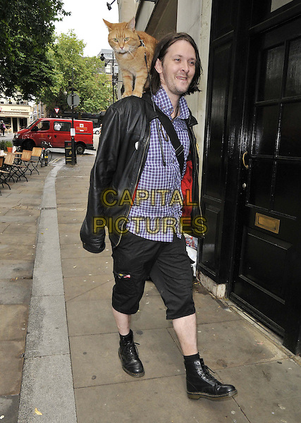 "LONDON, ENGLAND - JULY 19: James Bowen & Street Cat Named Bob attend their new book ""The World According To Bob"" signing session , Waterstones, Islington Green, on Saturday July 19, 2014 in London, England, UK."