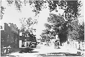 Street scene in 1924 Espanola.  A general merchandise store is identifiable.<br /> Espanola, NM  1924