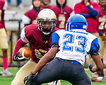 WATERBURY,  CT-101219JS26- Sacred Heart-Kaynor's Takai Coleman(33) tries to get around Crosby's Stephen Diggs (23) during their game Saturday at Municipal Stadium in Waterbury.<br /> Jim Shannon Republican-American